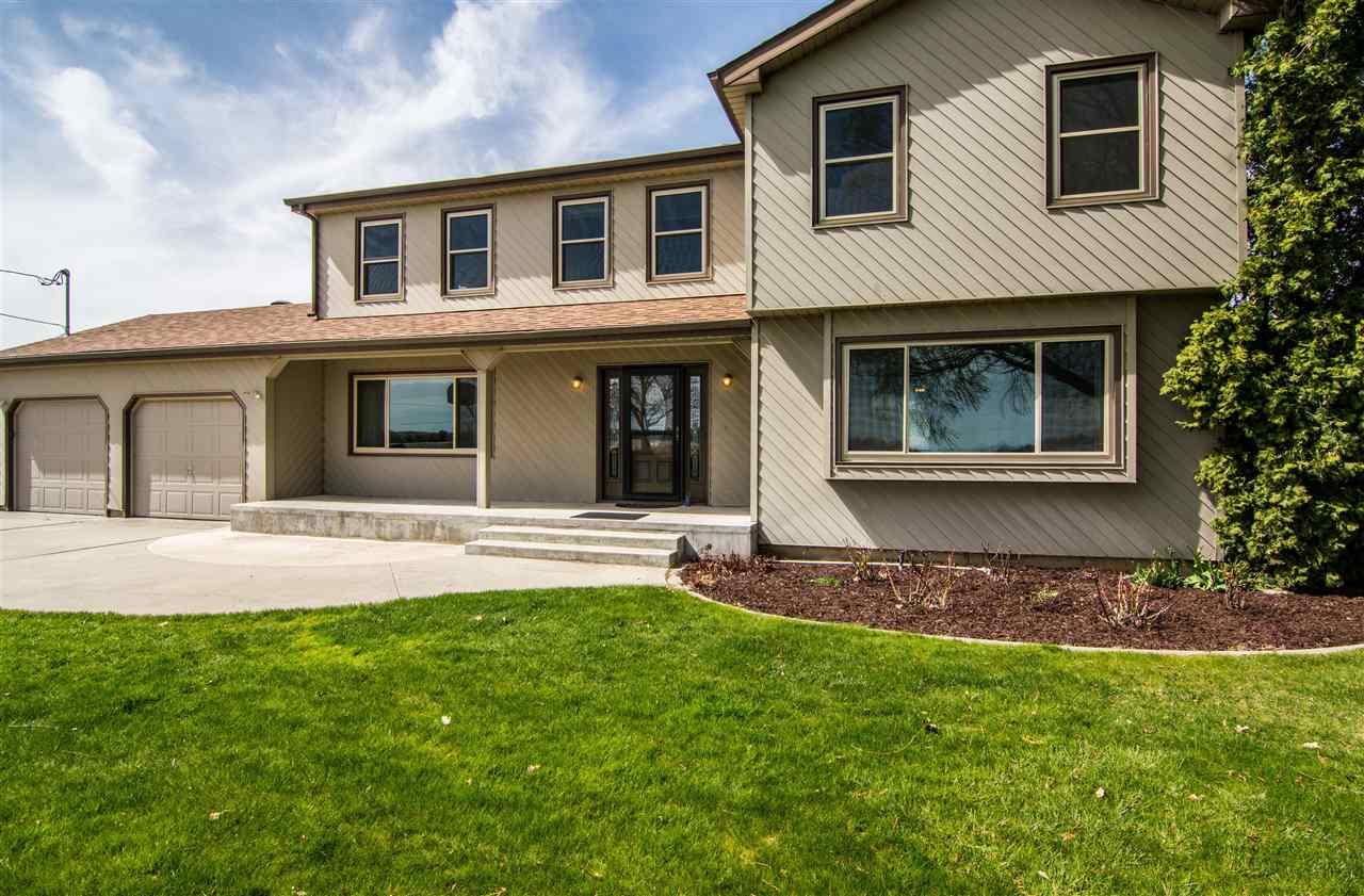 New Roof on house 2017,new vinyl windows 2015, new front door 2016, granite counters in kitchen 2016. Tile floors in kitchen and utility. Jetted tub in master, double sinks both upstairs bathes. 2975 sq ft shop/barn, with another 1042 sq ft under a roof, 4 stalls, extra storage, office and insulated and cooled meat locker/cold storage. Fenced pasture.