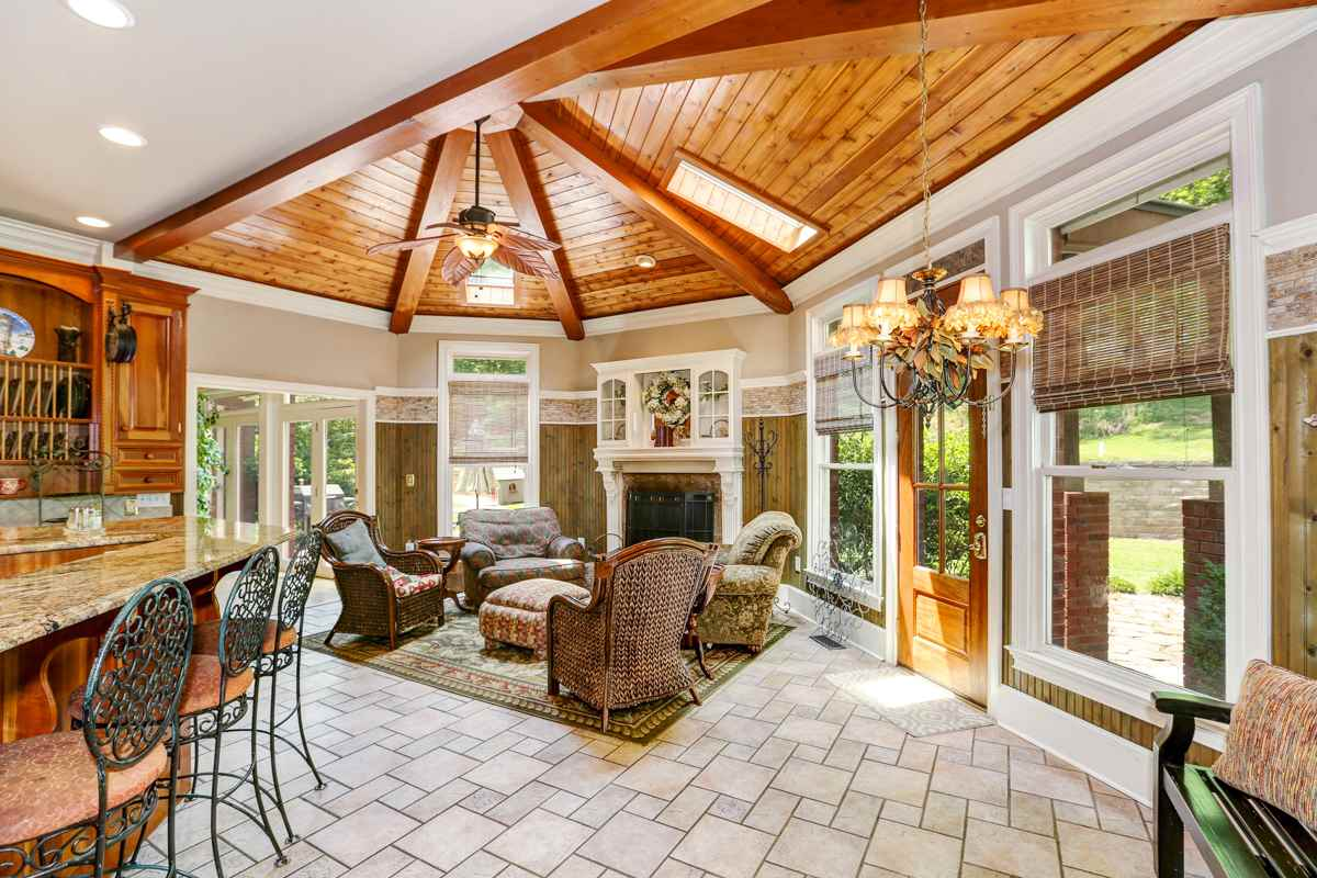 The kitchen has 14 foot ceilings and wood beams covering the vaulted skylight portion