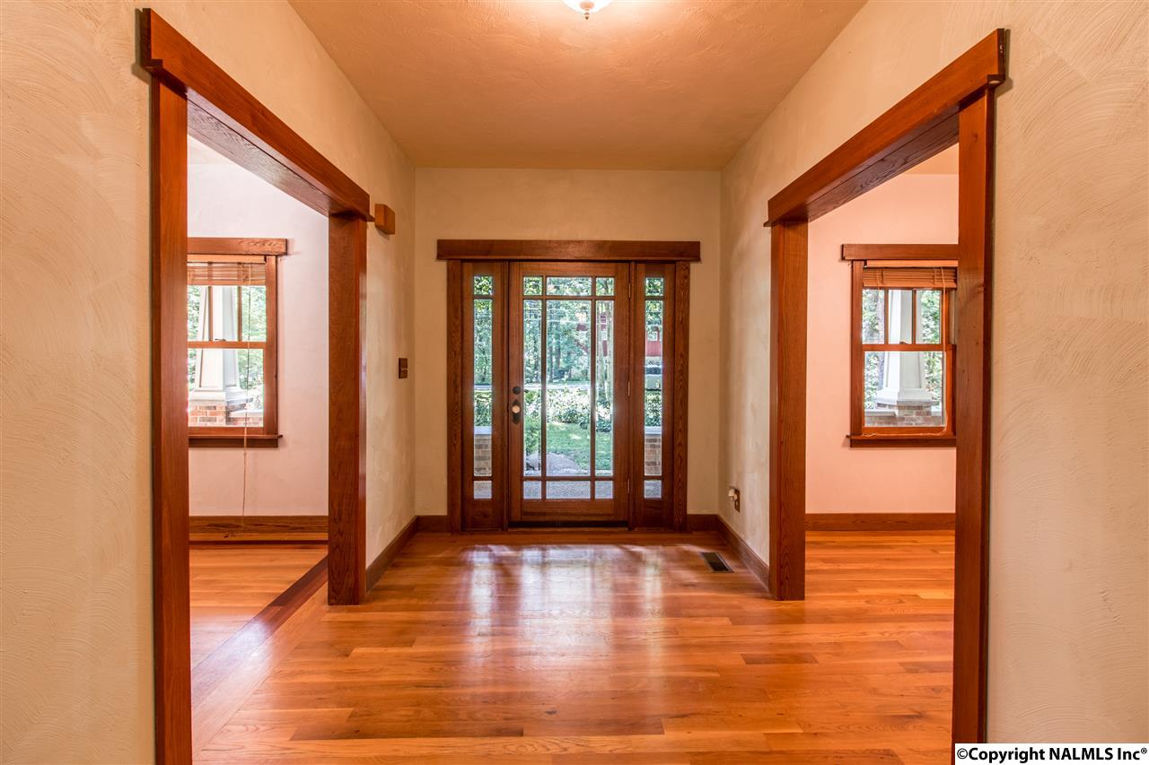 This huge foyer greats your visitors into this lovely home on Monte Sano.  The wood trim and hickory floors accentuate the Craftsman styling in this custom built home.