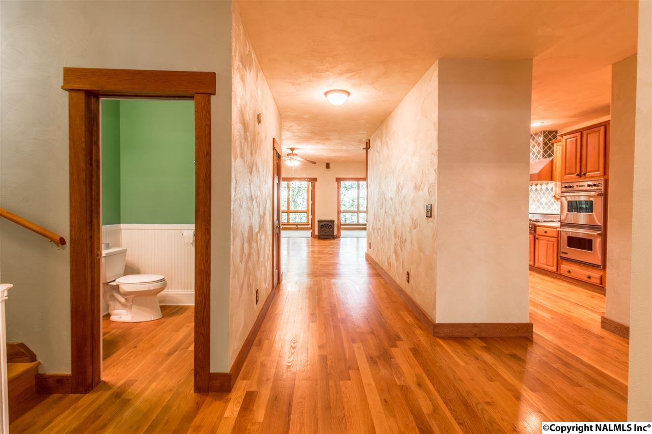 Large Foyer and hardwood floors, you can see all the way through the back view