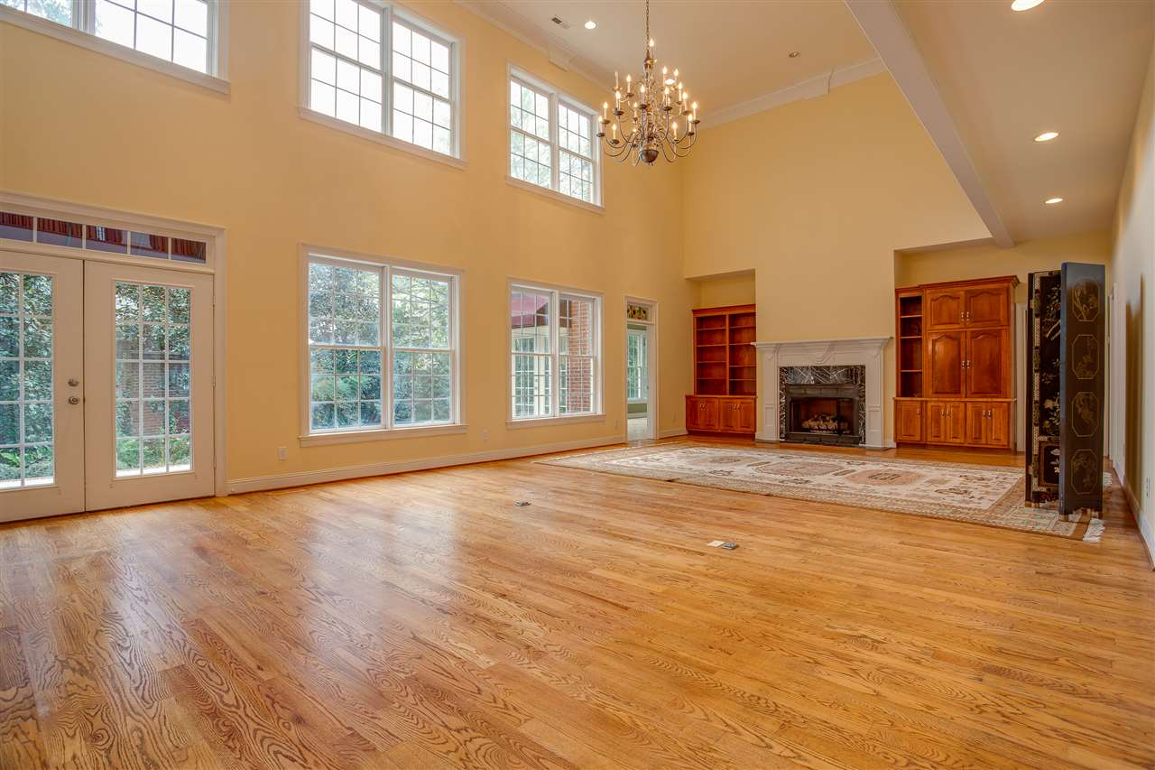 TWO STORY FAMILY ROOM WITH LOTS OF WINDOWS, BEAUTIFUL HARDWOOD FLOORS AND GAS FIREPLACE