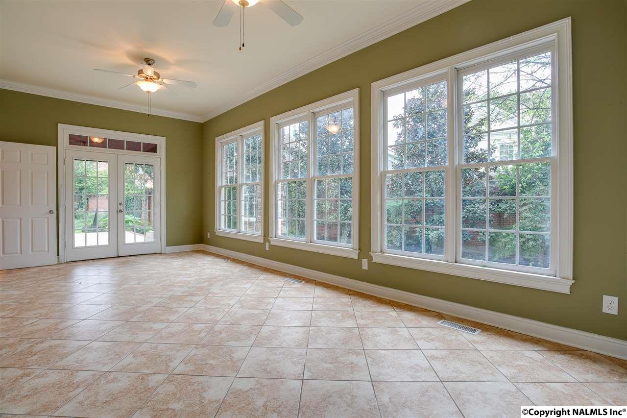 ENJOY YOUR MORNING COFFEE IN THIS LARGE SUN ROOM.