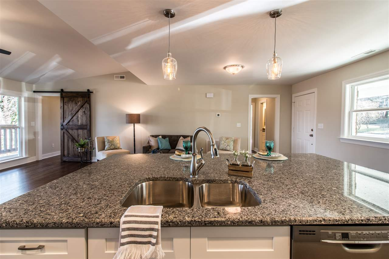 Isolated master BR has french door access to your deck for your morning coffee, a large walk in master closet and gorgeous master BA with walk in shower with frameless glass door and double vanity with granite.