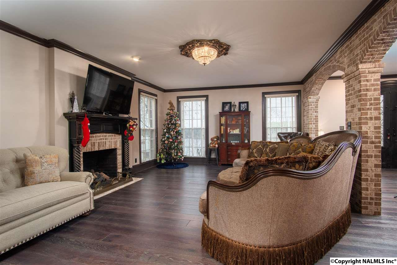 The living room offers plenty of natural light and one of two fireplaces.