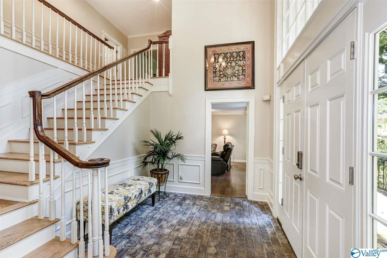 This light filled foyer looks out over Blossomwood towards Big Cove Road. This home has a unique and charming layout for tons of family fun.