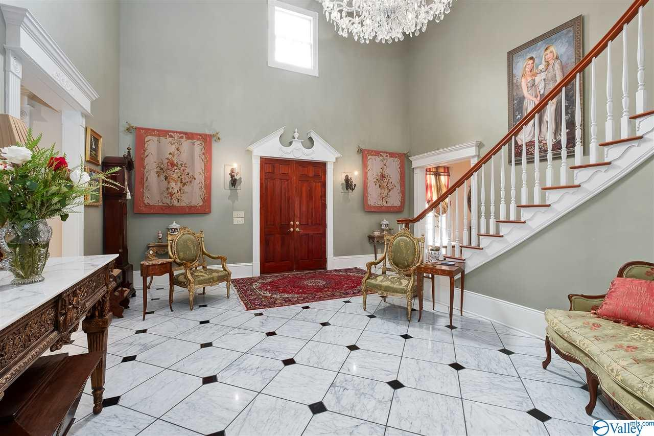 The elegant floors of the foyer are made from imported Italian marble.