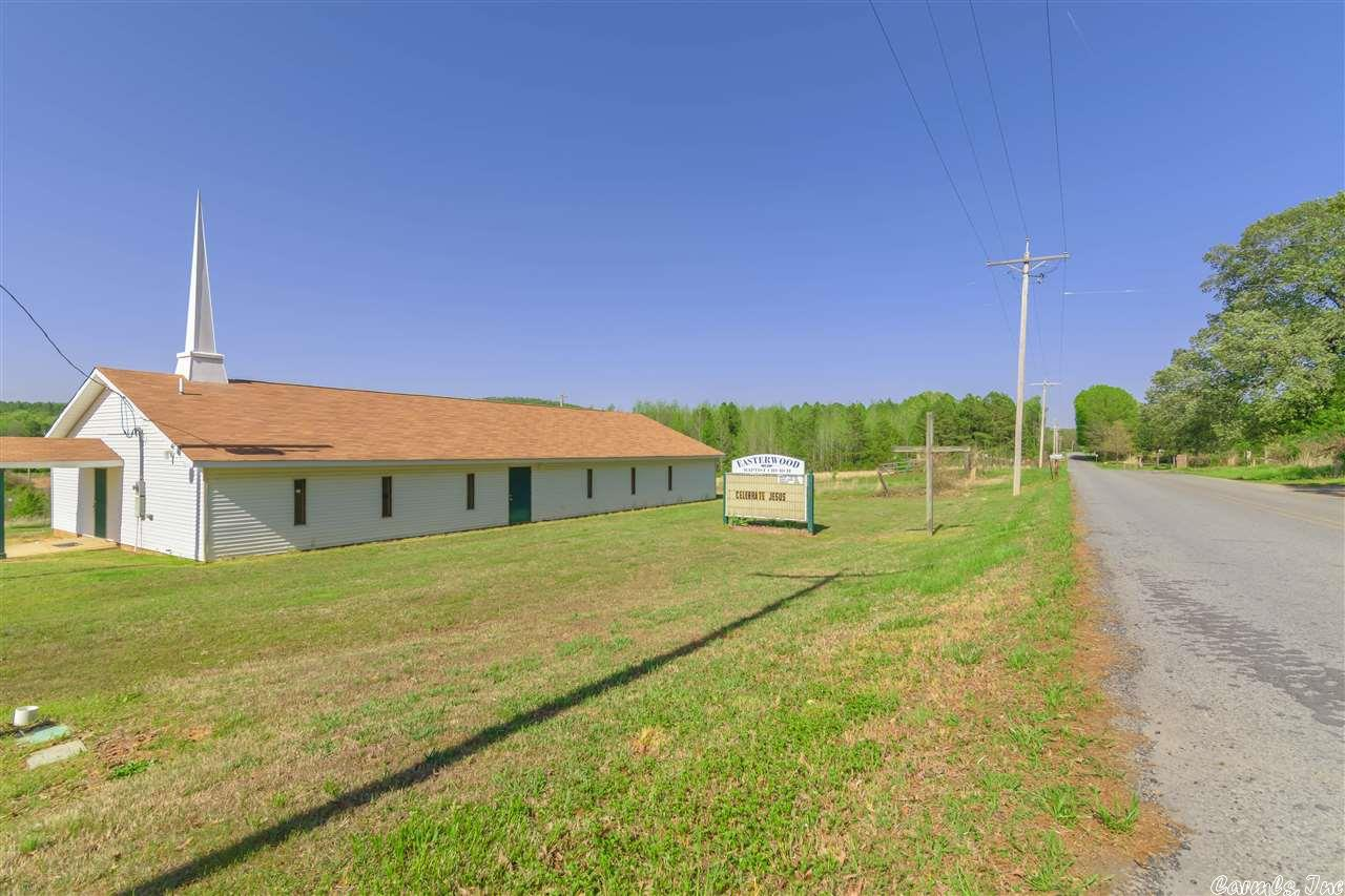 Investors!!!!  Could be possible to turn into a duplex.  Could continue as a new church.  Let your imagination run wild.    Lots of road frontage on North Point Road.    Storage building does not convey.    Main building contents are negotiable.