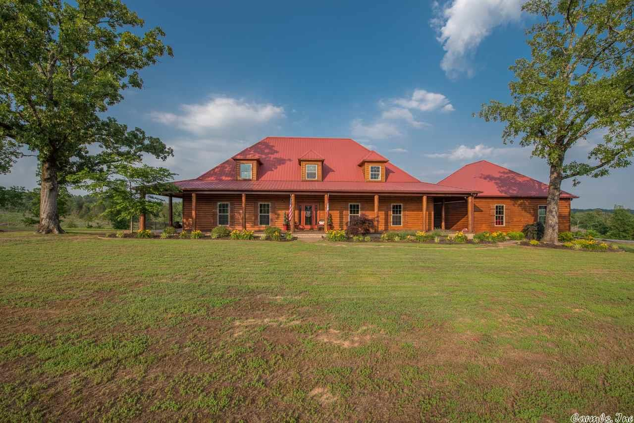 Stunning custom home on 10 pristine acres. Current owner's improvements have made this a rare country paradise--All land from back of home to tree line (once heavily wooded) professionally cleared. Cleared/added wildlife food plot behind tree line. Added all current landscaping (w/timed drip irrigation system), iron fencing, large asphalt drive, & professional stain on wraparound concrete porch. Log siding professionally cleaned & re-sealed in 2016. Furnishings are negotiable. 10'x16' shed does not convey.