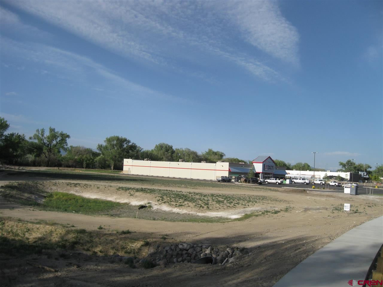 Excellent Development Potential On Bypass! Prime business frontage on new bypass boosts visibility, access, and traffic count! 1.93-acre (MOL) parcel of vacant commercial land. Zoned B-2 within City of Delta. Located in large commercial hub near Bill Heddles Recreation Center and Confluence Park. Also located just off Highway 50. Utilities available. Excellent opportunity to develop. B-2 allows for multi-family housing. Possible owner carry to qualified buyer!   Property has a FEMA Flood Certification and is also Opportunity Zone Designated.