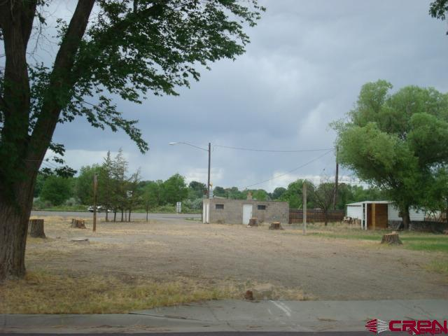 REDUCED SALES PRICE.           GREAT commercial parcel on Highway 50 - and Grand Street -  originally a small camp ground -  includes 3 water taps and  2 sewer taps.   Ideal for your business exposure -- easy access off highway   B2 ZONING   SELLER WOULD CONSIDER TRADE