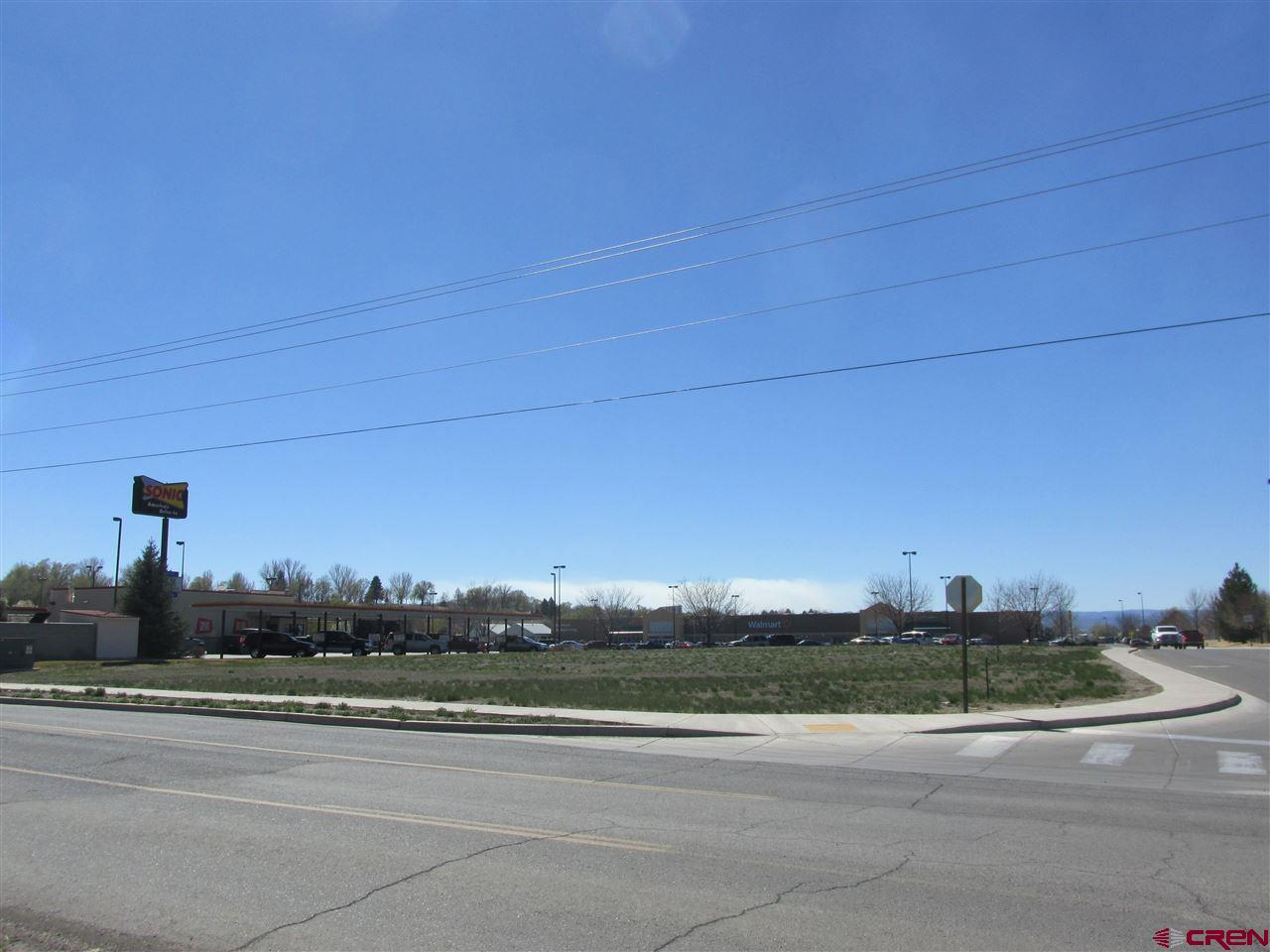 The Walmart Center Subdivision Lot 5. Corner Commercial Vacant Lot  Lot 5 is a .74 acre (MOL) vacant commercial lot located in the heart of Delta's commercial hub. No owners' association fees! Situated in the Walmart Center Subdivision, at the entrance to Walmart Supercenter and adjacent to The Delta Center. Centrally located for shoppers from Delta and the surrounding communities. Only Walmart shopping center within a 20-mile area. Located just off Highway 92 next to Sonic. Curbs, gutters and sidewalks already installed. Utilities are available. Ready for construction. Excellent location for your business!