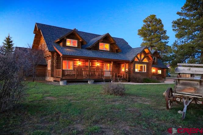 "Spectacular custom full log home built by Mike Moore. If you have been dreaming about some day living in a log home, this is a must-see. Everything about this home is upscale. The home sits on 5 acres and is fenced for horses. The 2,200+ SF barn has 4 stalls as well as a section where you can keep your ""big-boy"" toys and a large motor home out of the weather. There are views of Pagosa Peak to the North and Chimney Rock to the West. Location is excellent. This home is situated on a very quiet street in Meadows I, with no Homeowners Association looking over your shoulder.  This neighborhood is only 5 minutes away from shopping, restaurants, hospital, churches, and a 27-hole golf course. Above the 3-car garage is an unfinished area which could be easily converted to guest or in-law quarters. Just a few of the special features of this beautiful home are granite counter tops, Thermador stainless appliances, in-floor radiant heat, solid red oak floors, and large covered decks.  A picture is worth a thousand words, so take a look at the virtual tour of this fabulous home!"