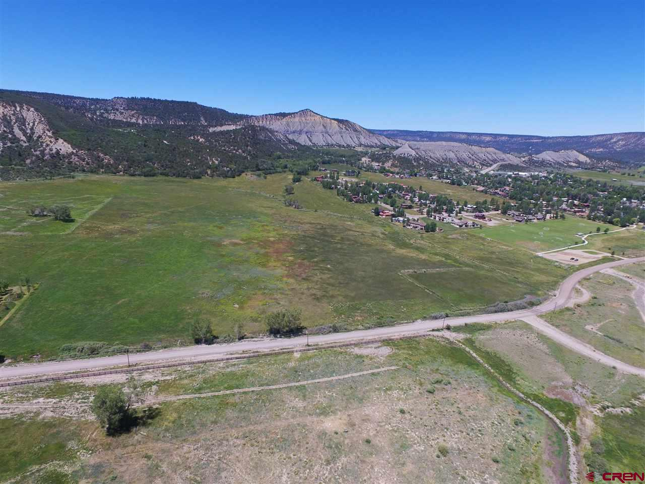 This 177 acres borders the south side of Town of Ridgway for 1/4 mile.  54.8 acres irrigated with water rights and lush grassy meadows.  Abundant wildlife.  Great views of the Cimarron Mtns.  The acres of 177 is approximate!