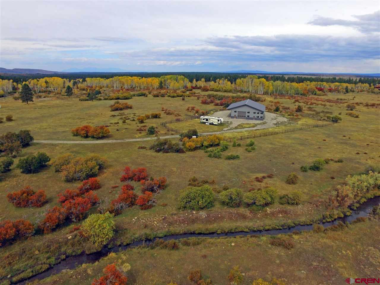 "Build a dream home on this gorgeous 35+ acres that already has a huge 4800 Sq.Ft. wood frame building with metal siding, a Conex Storage Box and Corral Panels included.  It is one of the only lots that joins it's designated Open Space within the Subdivision. This could be a Mountain Retreat or setup permanent residence at the base of the Lone Cone. <a href=http://www.listingsmagic.com/159191 target=""_blank""><b>Click here for virtual tour</b></a>"