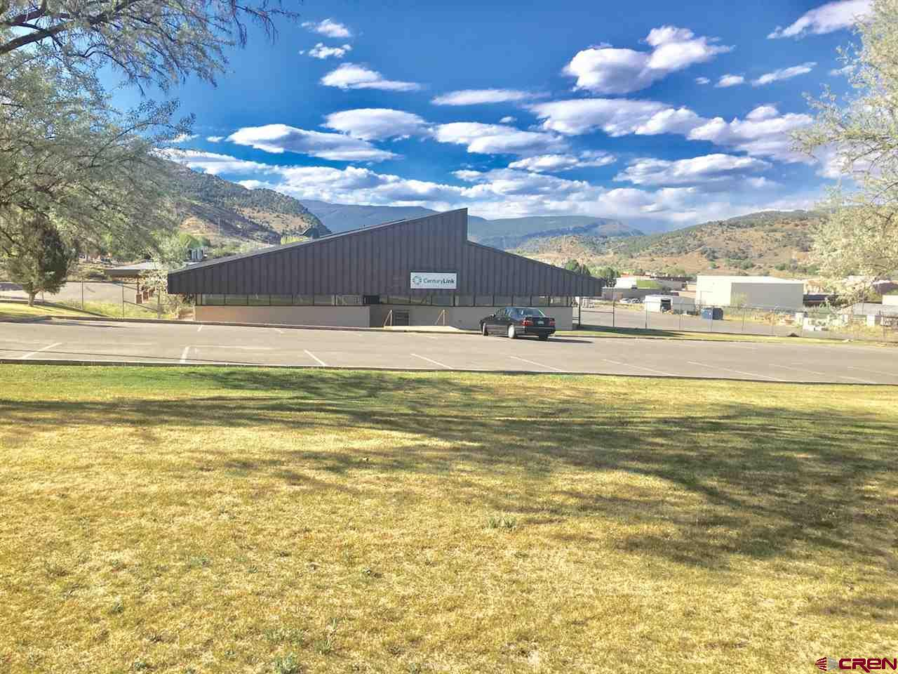 4 acre prime commercial site and/or industrial use in Bodo Park in the City of Durango, Colorado. Existing 5,329 sf office/warehouse, with two 5,500 sf covered carports with electrical piped to each parking spot.  Includes a portion of the carport that is double height. The site may possibly be subdivided into two or 3 lots subject to City approval. The site was originally purpose built for Mountain Bell and needs cosmetic upgrades.  Property includes newer asphalt throughout with a parking lot in front of the building in addition to large fenced area that is partially paved. Long-term tenant is moving out offering opportunity to re-purpose and maximize use of the property. Seller is open to sale or lease, and will entertain build-to-suit or joint business proposals.
