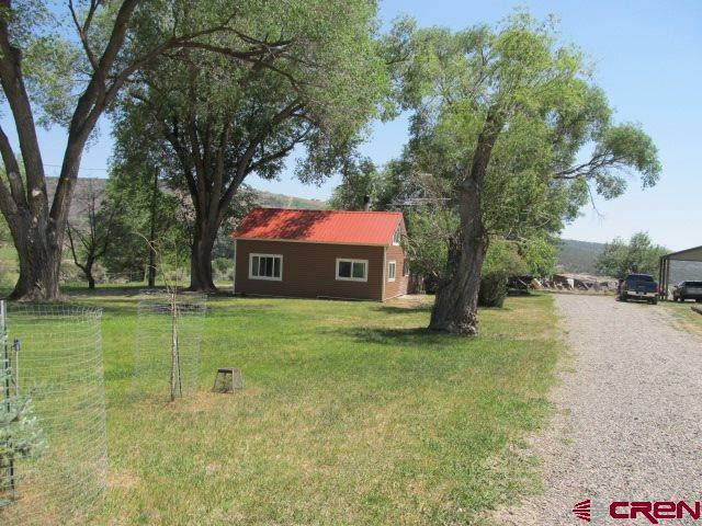 78+ ACRES, VIEWS, CREEKS!  If where you live is important, this property is a rare find with approximately 50 acres in pasture/grassland and variety of terrain, live water via two creeks, lovely charming farmhouse, huge shop, irrigation, well, fenced and cross-fenced.  Beautiful views of Grand Mesa, the valley and rock outcroppings.  Comfortable 4 bedroom/1.5 bath vinyl sided home has spacious sunroom/family room with large windows and pellet stove, living room with wood stove, family eat-in kitchen with lots of storage and two pantry closets.  Propane HWBB heat.  Escape to the country and make this your home!
