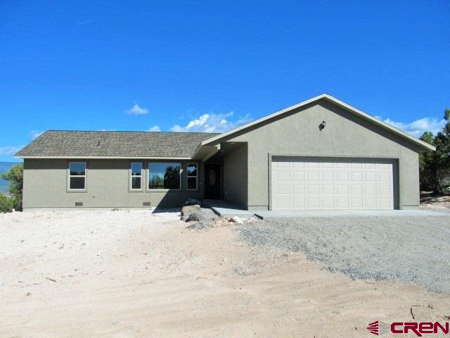 This brand new 1800 sq. ft. 3 bedroom, 2 full bath home sits in a private location on 2 acres with wonderful Grand Mesa views.  Inside has split bedroom floor plan with open concept living area.  Beautiful custom cabinets and pantry in the kitchen, Huge master suite with separate shower and tub, walk-in closet and beautiful views from the windows.  Two car attached garage without any steps to get inside the home.  All is brand new.  This lovely home is just waiting for your own personal touches.  Come take a look, you won't be disappointed!