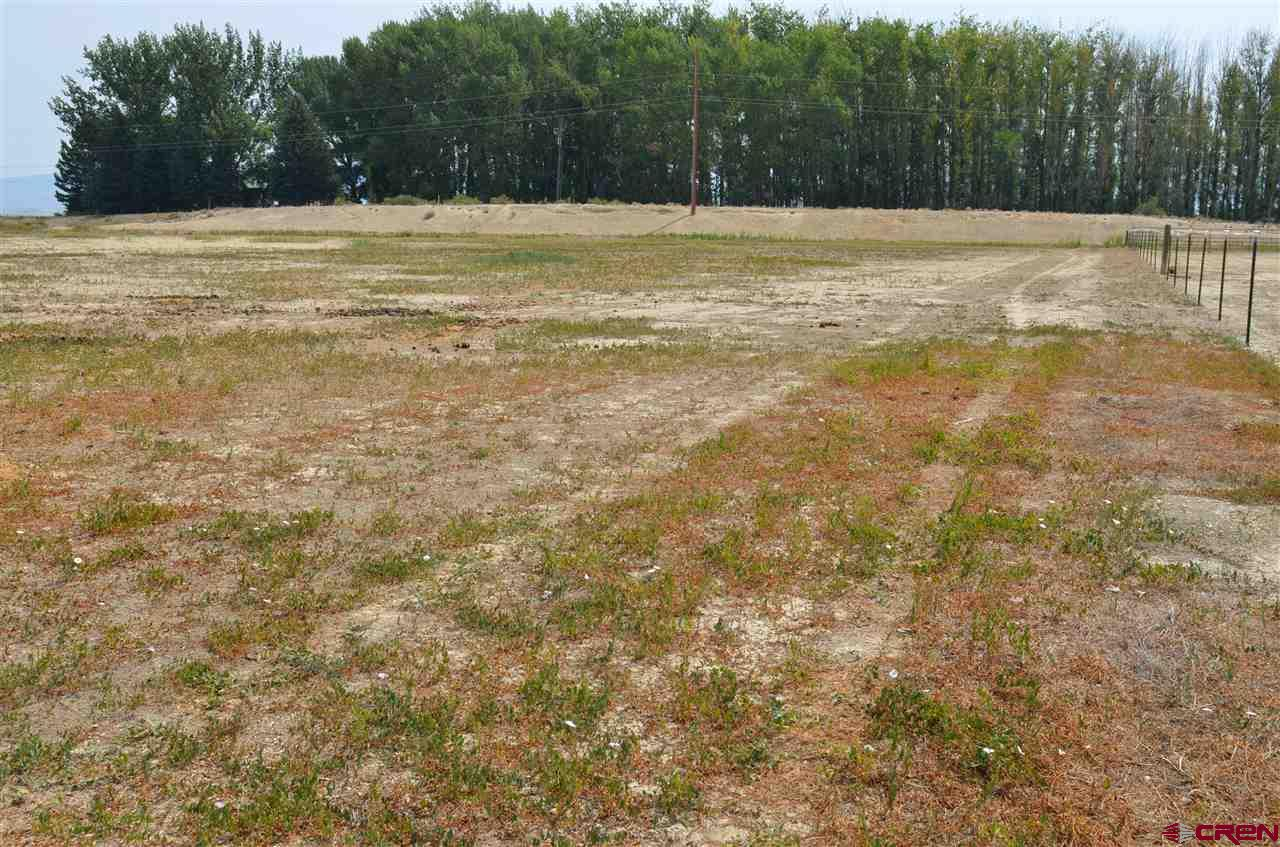 If you are looking to grow crops or just build your dream home, then check out this property which includes 6.7 shares of irrigation through UVWUA. Irrigation cost $250/year. Tri-County Tap available, but not paid for or installed. Also, a septic will be required. Modular or Manufactured allowed.  Last, but not least there are incredible views.