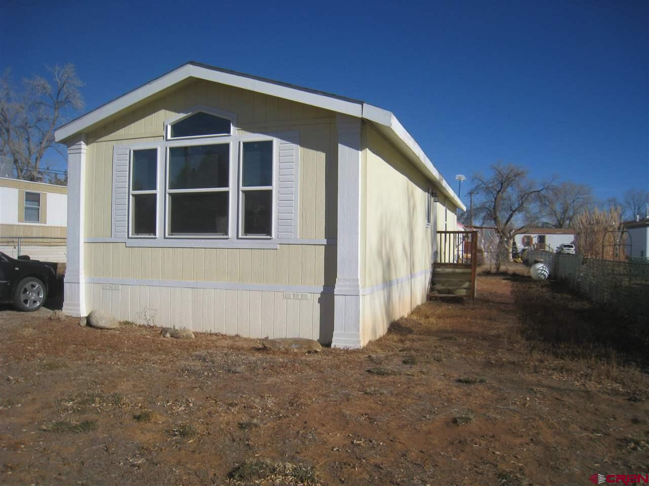 Very nice affordable housing in Cortez.  Space rent is $300 per month. Manager is on site.  2011 Cav (18' x 56').  No real estate included, manuafactured home only.