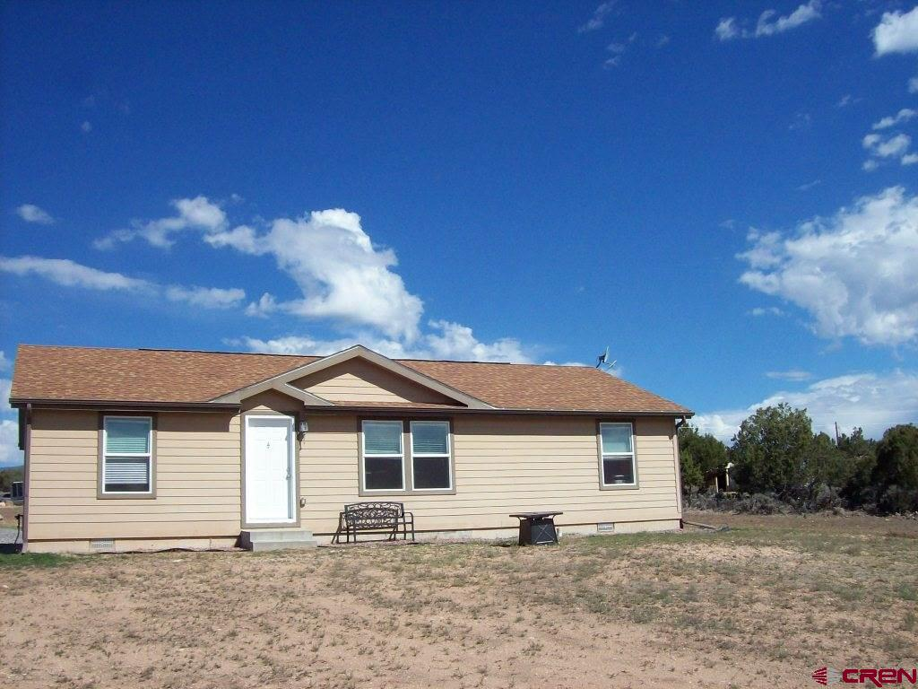 This attractive three bedroom, two bath home is situated on 13.52 acres on Cedar Mesa to take advantage of the the wonderful views.  The Grand Mesa is to the North and West, and the San Juans and West Elks are to the South and East, with a great view of the valleys below.  This true modular home is just like new with all new carpet, a wonderful open feel, split bedroom floor plan and in immaculate condition.  Location is just right for enjoying the freedom of no covenants.  In the country yet only about 4 miles from Cedaredge, this convenient location gives one the best of all worlds.  Great proximity to Grand Mesa for enjoying all four seasons: skiing, hiking, fishing, snowmobiling, ATVing.