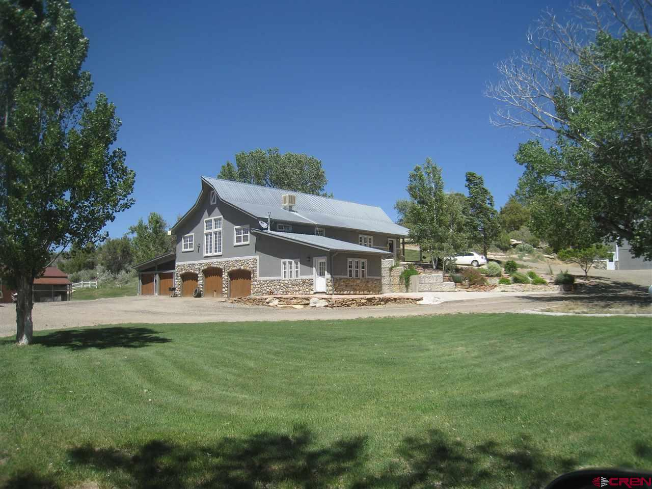 This higher level of home is nestled in some the counties historically productive farm ground area's with outstanding views of the Sleeping Ute Mountain. Splashes of granite and tile adorn the 4 bedroom 3 bath home with lots of open living area and a very functional floor plan. Amazing landscaping with a reflection pool and outside patio creates a very inviting atmosphere for entertaining and relaxing overlooking the very productive irrigated pasture of hay. 5 Car garage and an outstanding 35' X 50' , high ceiling barn plus a 20' X 50' lean to  leaves plenty of room for toy/boat storage and agriculture equipment needs. Plenty of irrigation water and plenty of privacy.  Pasture recently replanted with Alfalfa/Hay mixture, 70% orchard grass 30% tall fescue.  Plus band brand new side roll irrigation equipment for pasture!