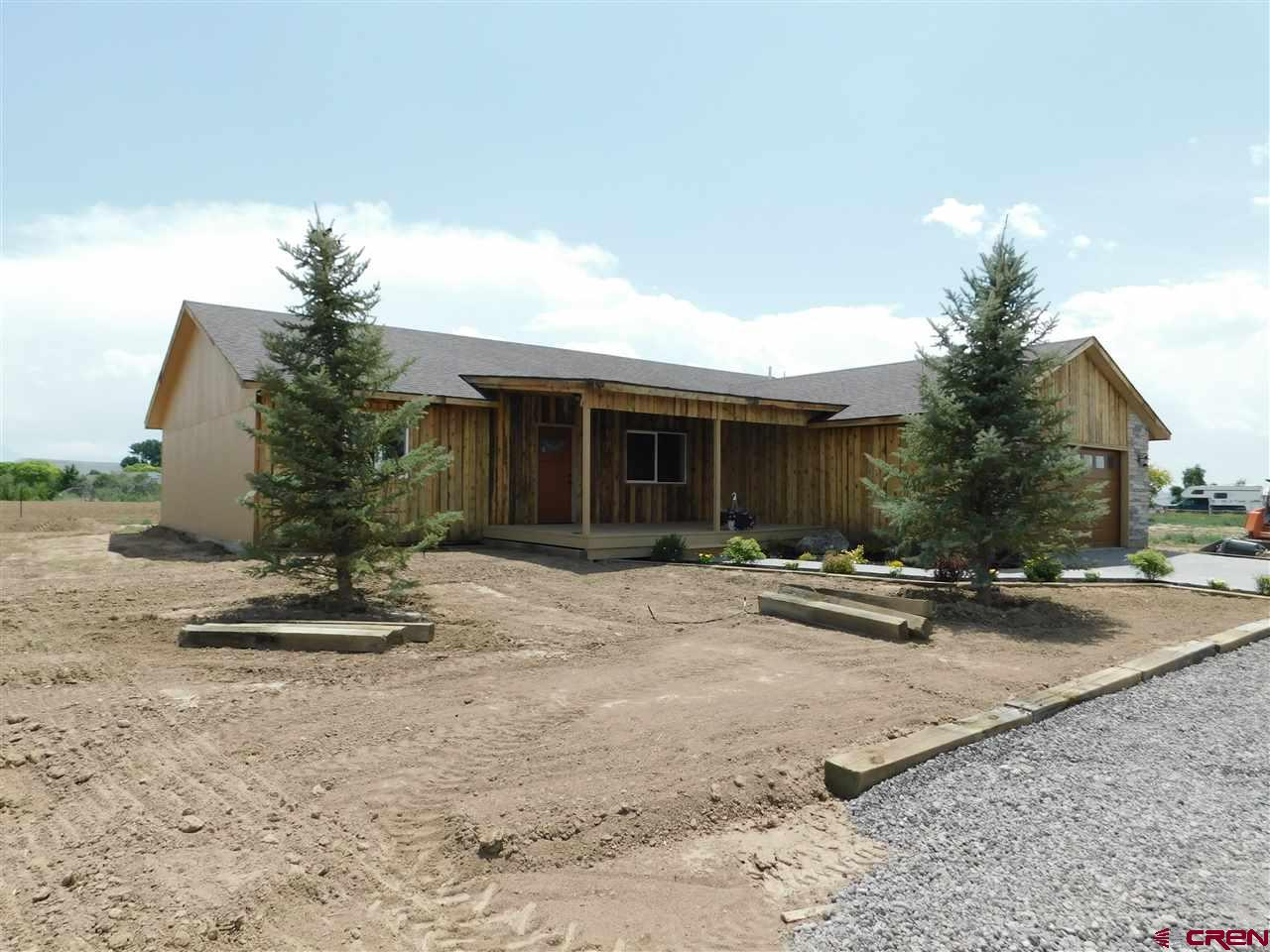 Brand new home on 7.47 acres with Grand Mesa views. Three bedroom, 2 full bathrooms, ranch style home with open floor plan. Large covered back patio to enjoy the views. $5,000 landscaping allowance credited to buyer at closing. Gorgeous kitchen with all appliances included. Vaulted ceiling. Large laundry room also includes your new washer and dryer. This land provides many opportunities for any buyer to enjoy. 8 Shares of Orchard City Irrigation District water. Horses allowed. Good location for Delta or Cedaredge schools.