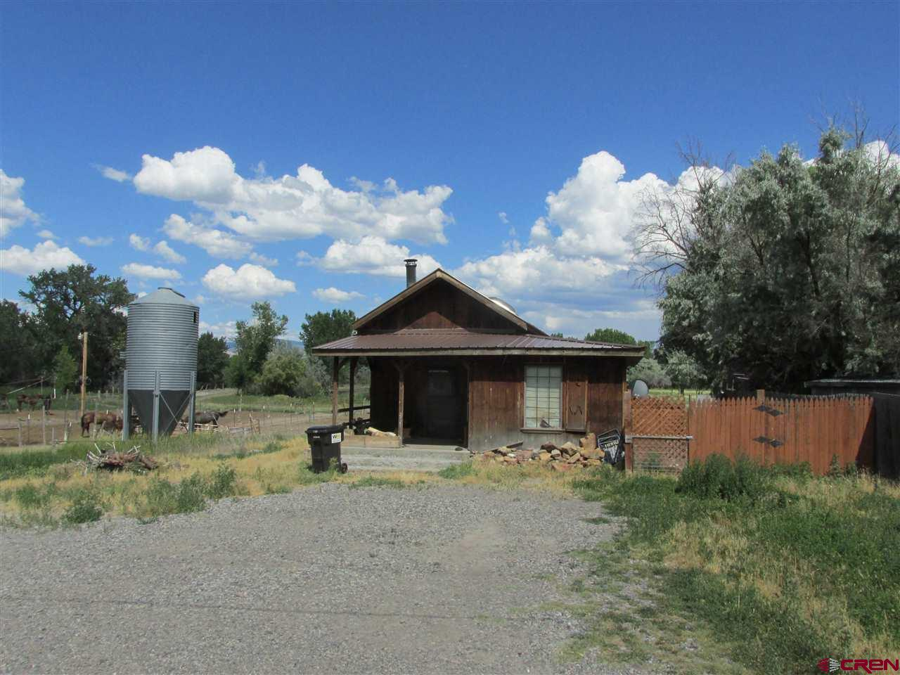 Superior Investment Property! 16.81 acres (MOL) zoned B-4 and R-3 within the City of Montrose and next to the new Colorado Outdoors 164-acre multi-use river development. Sizeable acreage for commercial and/or residential development. Property has 696 sq.ft. 1bd/1ba home, pasture, ponds and horse stalls that are currently leased. Property also has irrigation rights. Beautiful acreage and nature views. The possibilities are endless with this land! There is an estimated 2021 split fee of $500 for UVWUA for this property.