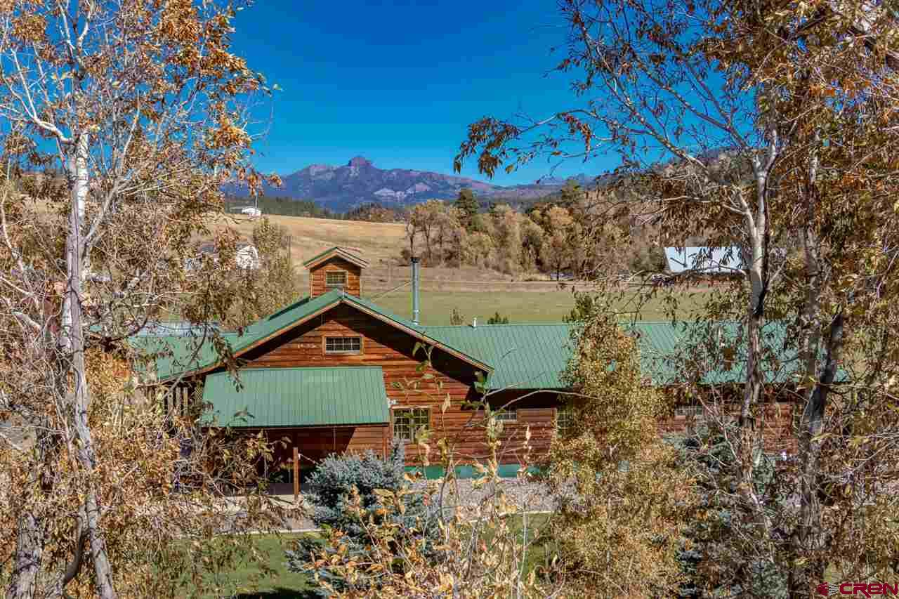 Welcome to the riverfront property of your dreams! Continental divide, San Juan Mountain views of the iconic Square Top? Check! A winding mountain river for backyard fly fishing, tubing and swimming? Check! Water rights? Check! Separate guest quarters? Check! Over-sized 1000 square foot garage with extra garage door for working on your toys? Check! Wrap-around 1800 square feet redwood deck with built-in BBQ and hot tub? Check! These owners spared no expense in creating this dream property. The 2700 square foot single level 200-year-old reclaimed timber frame home is designed for entertaining: gourmet kitchen, custom cherry floors and cabinets, wet bar and river rock fireplace. With $1.25 million to replace what they built, this property provides a great value. It would make an excellent high-end vacation rental for a large family or corporate retreat. Guest quarters have a separate entrance and could be their own vacation rental, long-term rental, guest suite or caretaker's quarters. The potential uses for this must-see riverfront home are endless. Please see associated docs for a complete list of features and inclusions.
