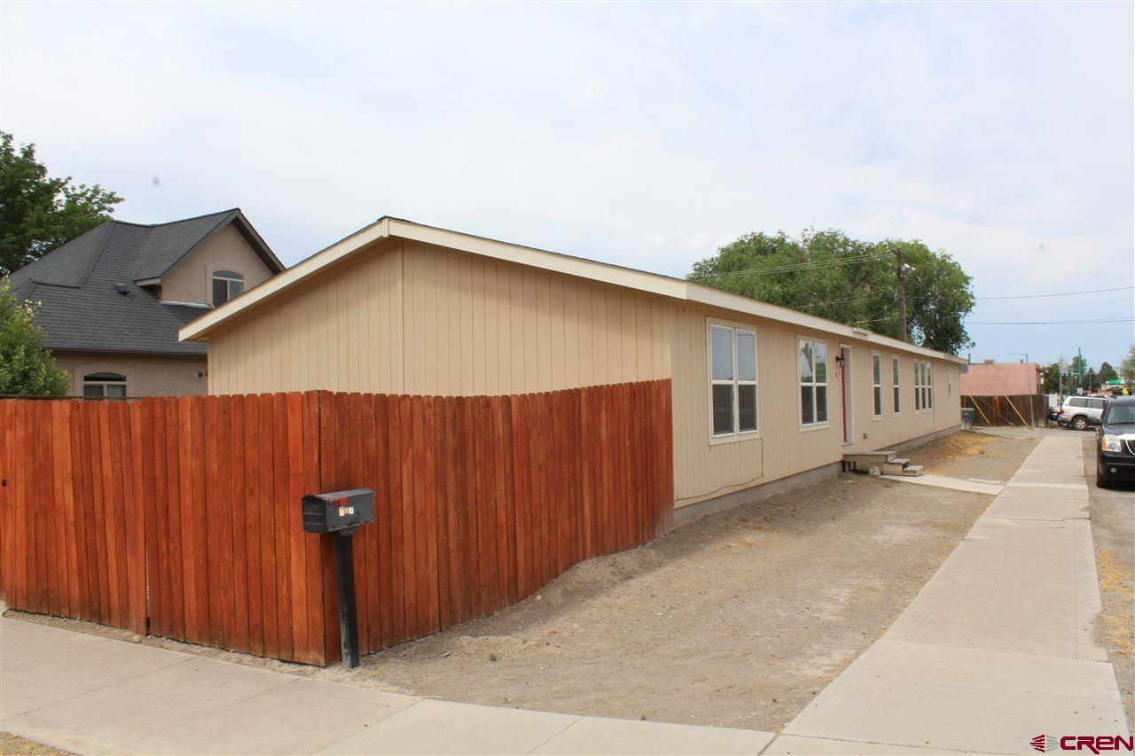 The possibilities are endless! Property zoned B-2. Large 4 bedroom 2 bath modular. Large garage, home has been very well taken care of! Great seating area in the back to enjoy your evenings. Or you can bring your business here with great frontage location! Garage has hot and cold water hookups x 2 as well as a 220 electric hookup. RV parking and dump as well! Call today for a showing!