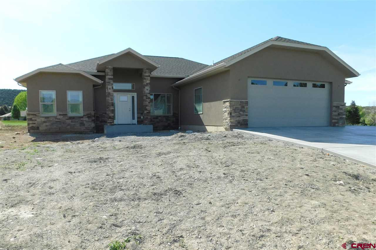 Brand new home going up! This beautifully designed home backs up to 4th Fairway on Cedaredge Deer Creek Golf course. Open floor plan with large kitchen and center island. Design includes foyer, dining room and large living room. Master bedroom offers private access to the covered back patio. Master bathroom includes double sink vanity and large walk in closet. Attached garage is a two car plus third bay for golf cart, workshop or extra storage! Pictures will be updated as construction continues. Please see pictures for house plans and exterior design.