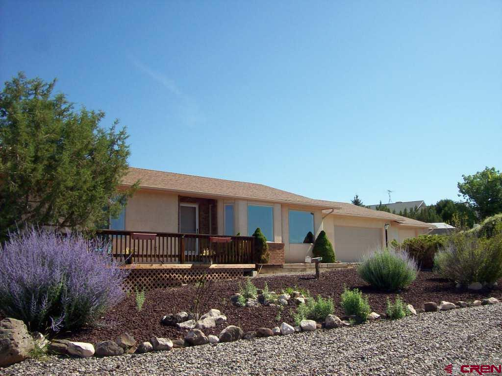 Amazing views of the surrounding mountains from the decks on this wide-open Cedar Mesa home.  Just over 1800 square feet, open concept living area with dining area, spacious kitchen and living room with a bay window, three-car attached garage, fenced back yard with a separately fenced garden area, two mature sweet cherry trees and natural cedars make this country home feel like part of nature.  The front yard is xeriscaped, back yard has plenty of room for a lawn if desired.  The large storage shed in back provides space for any yard equipment or patio furniture.  A private patio in back provides a nice get-away.