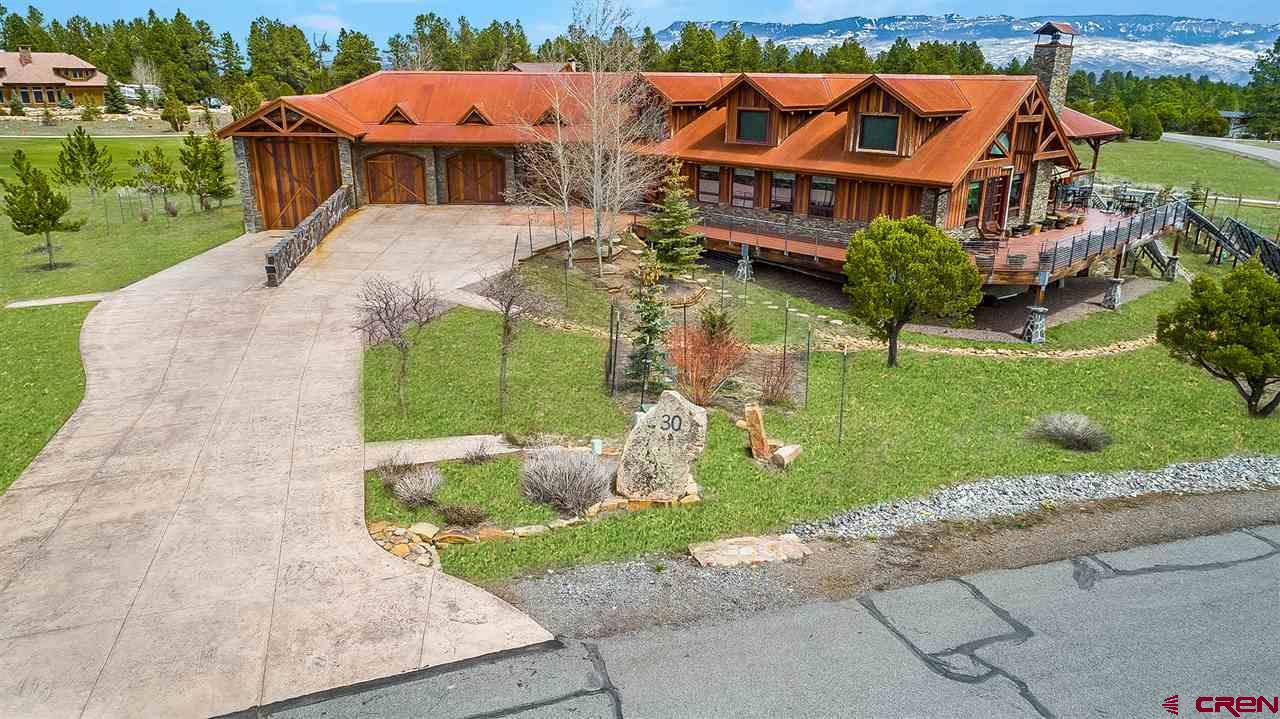 Elevated on an acre overlooking the second hole sits this exquisite Fairway Pines Estate.  This impeccably crafted home exudes sophistication and charm with a floor plan ideal for entertaining and everyday living.  With over 7,000 Sq ft, this is a one-of-a-kind residence that boasts 4 spacious bedrooms complete with walkout patios and ensuite bathrooms.  The kitchen is spacious and stunning with a large Italian island, solid Alder cabinets, top of the line appliances and a butler's pantry.  Master suite includes an oversized office, San Juan views and a private balcony!  Entertain downstairs in style surrounded by a hand crafted Alder and copper bar, warm hardwood, home theatre, work out room and craft room.  Heated garage equipped with an RV bay and a separate workshop with 220v.  Solar assisted and energy efficient, the sellers have spared no expense.  This home comes with ONE lifetime Golf Membership with no additional transfer fees, cart or green fees other than the yearly HOA dues.
