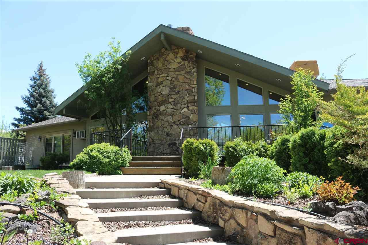 Enjoy the sounds of the running water off your backyard while you sit on the deck and soak in the views of the golf course and Grand Mesa from this stunning golf course dream home!  4000 square feet has never felt so cozy.  The main level hosts two master suites, laundry room, kitchen, living room with a gas fireplace and trimmed with rock accents, and a 4th bedroom which could be a bonus/hobby room.  A beautiful kitchen with space for dining has enough room for cooking for family or guests or just warming up a cup of coffee.  A separate spacious office rounds out the upstairs floor plan.  Vaulted Aspen tongue and groove ceilings and a lovely deck off the kitchen.  Master bedroom offers the peace and tranquility you can enjoy.  Down stairs offers a large family room destined for entertaining, complete with a wet bar and stamped concrete patio.  This area offers privacy not common on the golf course.  The oversized 3 car garage will hold lots of toys to enjoy in our wonderful community.  Beautiful landscaping.  Tons of storage throughout the home.    So much to offer on this truly one of a kind golf course property with covenants but no HOA.  It was built with love, lived in with love and is now ready for a new owner!