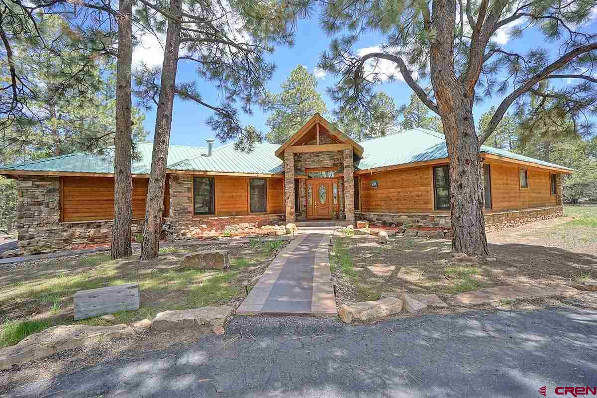 Beautiful Single Story Ranch style home with distinctive touches; hickory wood floors, tile, granite, high ceilings, and unique lighting. Unbeatable at $202.92 per square foot.  Large living room with gas fireplace off entry, separate dining area or den/office area, three guest bedrooms and two full bathrooms in separate wing from Master Suite area.  Stainless appliances in kitchen with dining area.  Home has layout allowing for easy access to all living and outdoor areas. Several open area around home for relaxing and entertaining outdoors. Completely covered outdoor kitchen with large deck for serving. Located in Log Hill, Dallas Ranch Golf Community.  This home is ready for your personal decorating style.  Three car garage provides room for work area, recreational equipment storage.