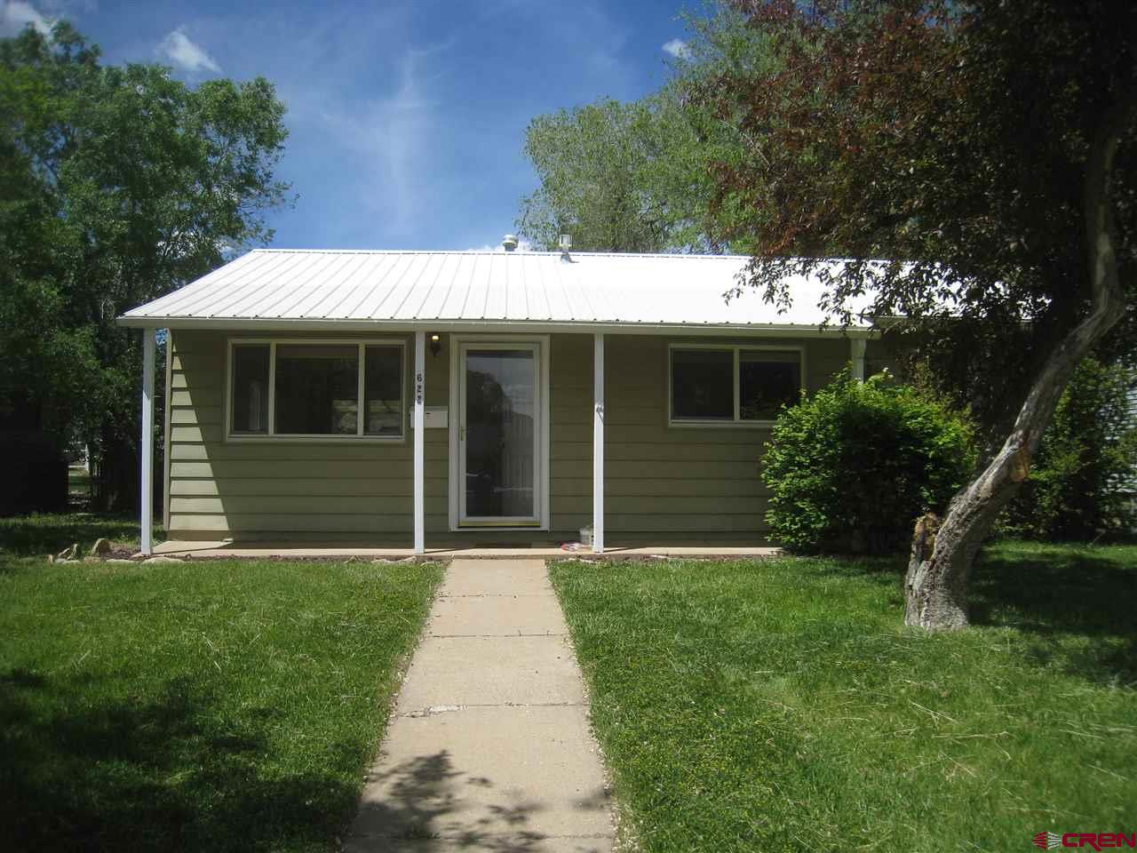 This home was just refreshed with new interior paint and refinished hardwood floors.  Great starter home in Cortez.  This 3 bedroom, 1 bath is very well maintained and move in ready.  Enjoy the evenings on your covered patio.  Professionally landscaped back yard.  All appliances included!