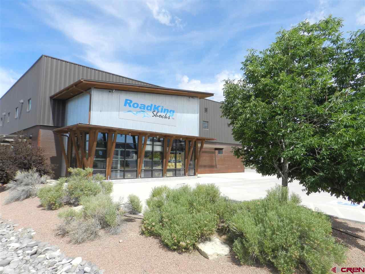 Perfect for investor or end-user, borders Colorado Outdoors! 6,787 sq.ft. commercial building (MOL) on a 0.85 acre lot. Large retail showroom, office space, service bay, wash bay with floor drain, and storage. Building has a security system. Fenced, paved yard. Ample off-street parking in large paved lot. Located just south of Montrose Regional Airport, near signalized intersection of N Townsend and N Grand Ave, and next to Montrose Ford. Strategically adjacent to the new Colorado Outdoors 164-acre multi-use river development. Easily accessible with a high-traffic count and extremely visible signage. Great location for retail, services, manufacturing, and professional offices. Property is fully leased until August 31, 2024. - Excellent Investment property. Neighboring 0.88-acre (MOL) vacant lot also available for sale (MLS # 582652). Incredible tax break with Opportunity Zone designation!