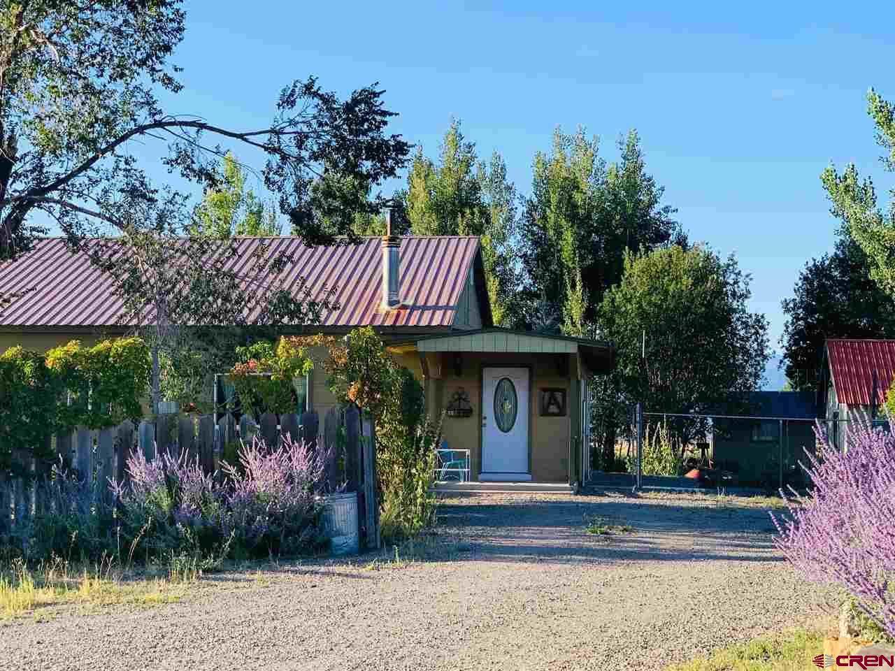 Wonderfully loved home on over 4.58+- acres with amazing views all around! Horses will love it!! Quality Hay Field and nice set up and fencing for Horses, Cattle or ??? Garden space already established with plenty of storage for all your tools! Great pasture for your critters with an updated shelter on the north field, irrigation system set up and ready for you to take over! Home has newer siding, energy efficient windows and interior painting! Geothermal was installed in 2010! Great inviting entry into the home with an open concept kitchen and living room with new flooring! 360 degree views from this great piece of land! Conveniently located just minutes away from Hotchkiss and a hop, skip and a jump to Paonia or Crawford!  Homes is on a quite country road but really close to all amenities.