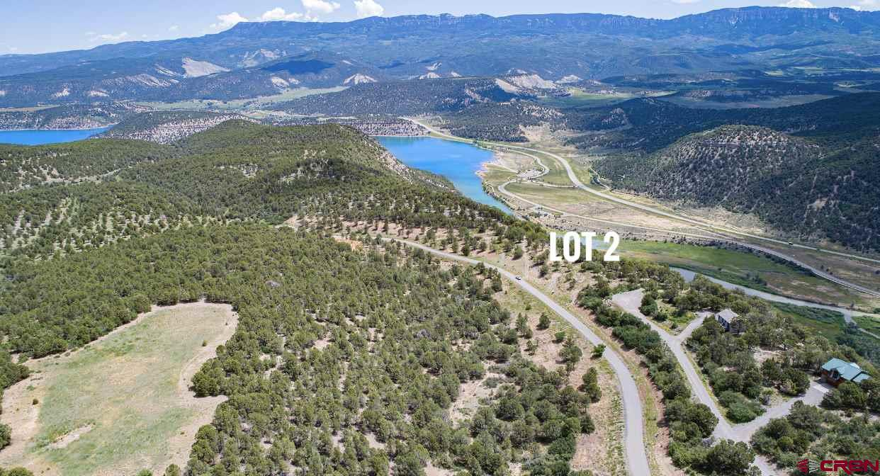 Enjoy the serenity of these exclusive Colorado home sites surrounded by the Rocky Mountains.  Pointe Escape's alpine landscape rises to 8,000 feet with expansive views of Ouray Valley, the San Juan's and Cimarron Mountain Ranges.  Home sites also oversee vast reaches of evergreen National Forest, rolling ranches and the Ridgway Reservior.  Nestled at the Eastern edge of Log Hill, Pointe Escape lots are the last few escarpment properties in the prestigious Log Hill Village subdivision.  The property features are one of a kind from paved road with no through traffic, utilities to each lot line, and the immediate use and access of over 23  acres of natural landscape and trails.  Close to Ridgway, the natural hot springs in Ouray and the world class skiing and shopping in Telluride.  In order to protect your privacy and ensure the best views possible, each lot has a specific building envelope.  Come see your impeccable views of 8th highest summit in the Rocky Mountains Uncompaghre Peak.  Revel in four glorious seasons of peace and beauty with your  unobstructed views of Mt. Abrahams, Mt. Corbett, The San Juan's, Cimarron's and the Ridgway Reservoir.