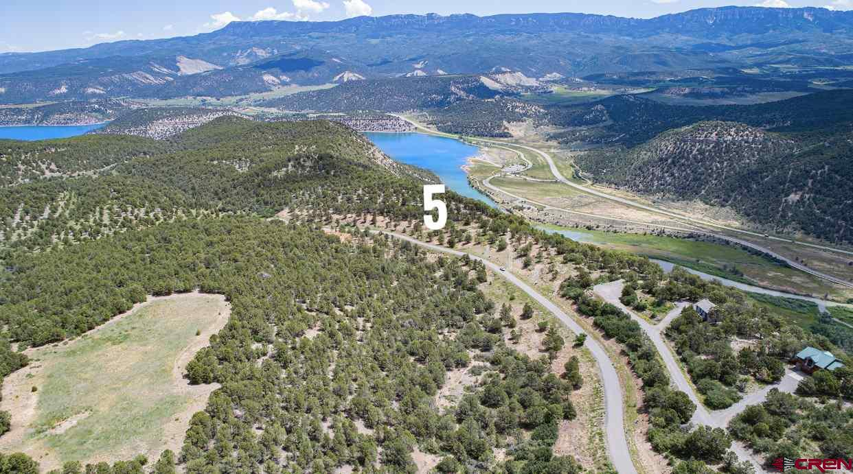 Enjoy the serenity of these exclusive Colorado home sites surrounded by the Rocky Mountains.  Pointe Escape's alpine landscape rises to 8,000 feet with expansive views of Ouray Valley, the San Juan's and Cimarron Mountain Ranges.  Home sites also oversee vast reaches of evergreen National Forest, rolling ranches and the Ridgway Reservior.  Nestled at the Eastern edge of Log Hill, Pointe Escape lots are the last few escarpment properties in the prestigious Log Hill Village subdivision.  The property features are one of a kind from paved road with no through traffic, utilities to each lot line, and the immediate use and access of over 23  acres of natural landscape and trails.  Close to Ridgway, the natural hot springs in Ouray and the world class skiing and shopping in Telluride.  In order to protect your privacy and ensure the best views possible, each lot has a specific building envelope.  Come see your impeccable views of 8th highest summit in the Rocky Mountains Uncompaghre Peak.  Revel in four glorious seasons of peace and beauty with your  unobstructed views of Courthouse, Chimney Rock and the Ridgway Reservoir.