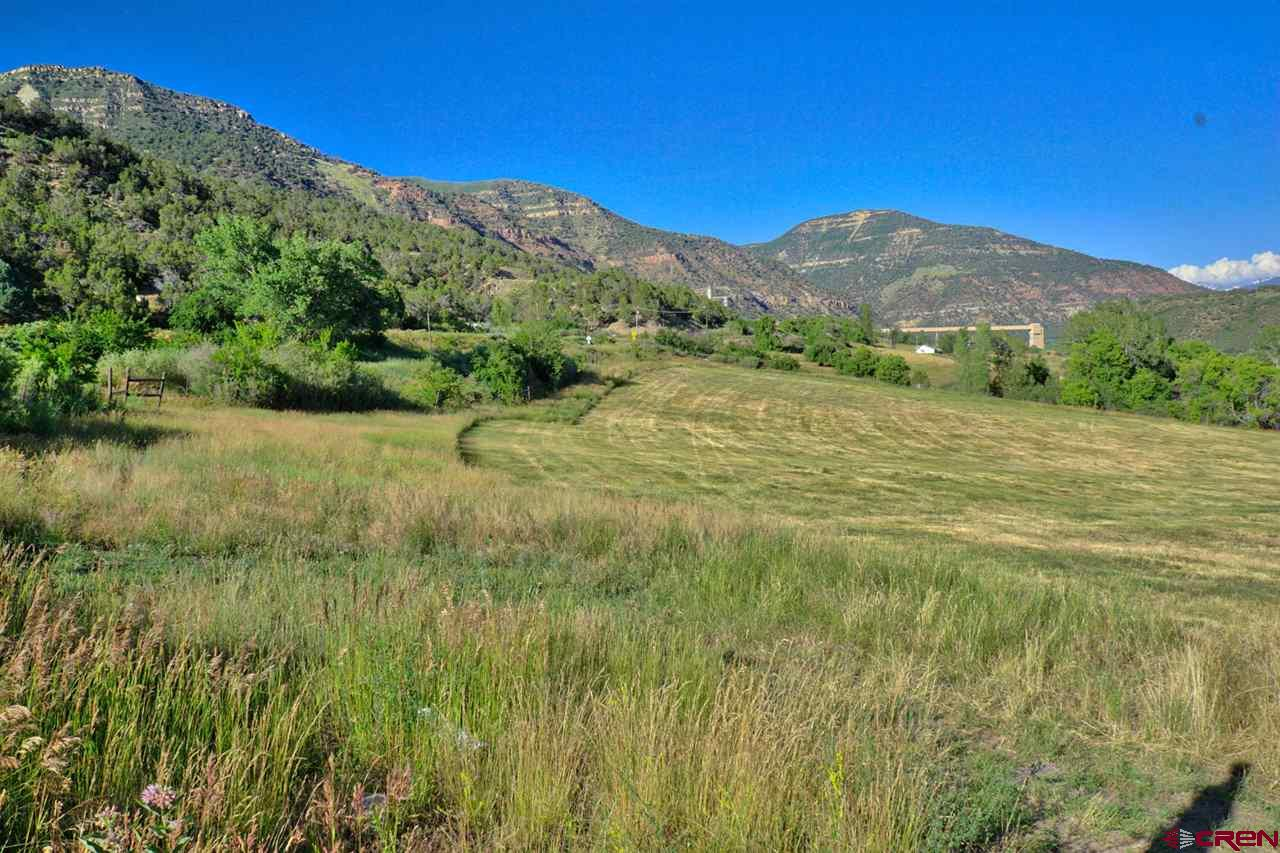 Scenic, quiet, pastoral. Valley and mountain views from this acreage located 8 mins east of Paonia. This parcel slopes gently to the south so would be perfect for a passive solar home. The North Fork of the Gunnison is just down the hill. No covenants.