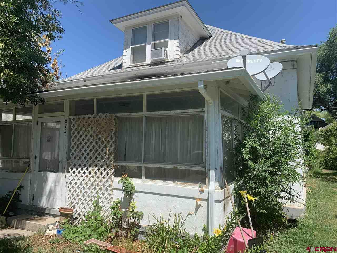 Excellent rental history, investment potential  with room for more cash flow due to the size of this four bedroom, two bathroom fixer upper!! Nice central Hotchkiss location within walking distance to schools, parks, fair grounds, shops, and more.  This is a gem in the making with some hard work and money...it will be that sweet spot you have been looking for to live or invest.