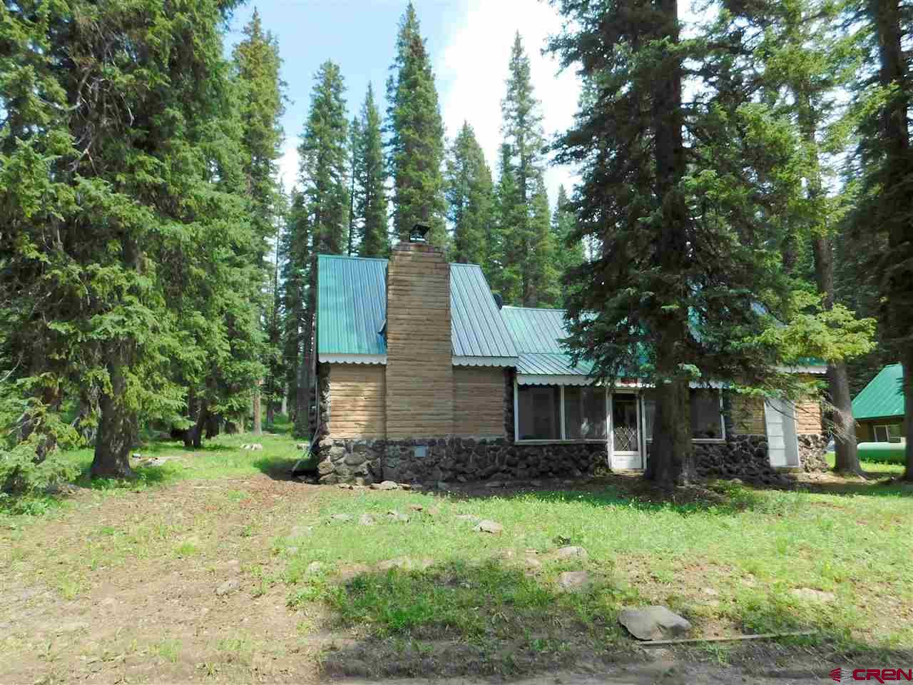 Cabin in the Grand Mesa Resort Company just a short walk away from both Baron Lake and Alexander Lake. Lots of hiking, fishing, ATVing in the spring, summer and fall plus unsurpassed snowmobiling, snowshoeing, or cross country skiing in the amazing snow of the winter. Cabin has both a water tap and a household well. Covered and screened front porch with attached storage room. Large living room offers a great space to gather around and includes a wood stove insert. Upstairs will sleep plenty of your family and guests! Two private bedrooms plus the open area. This cabin is being sold furnished.