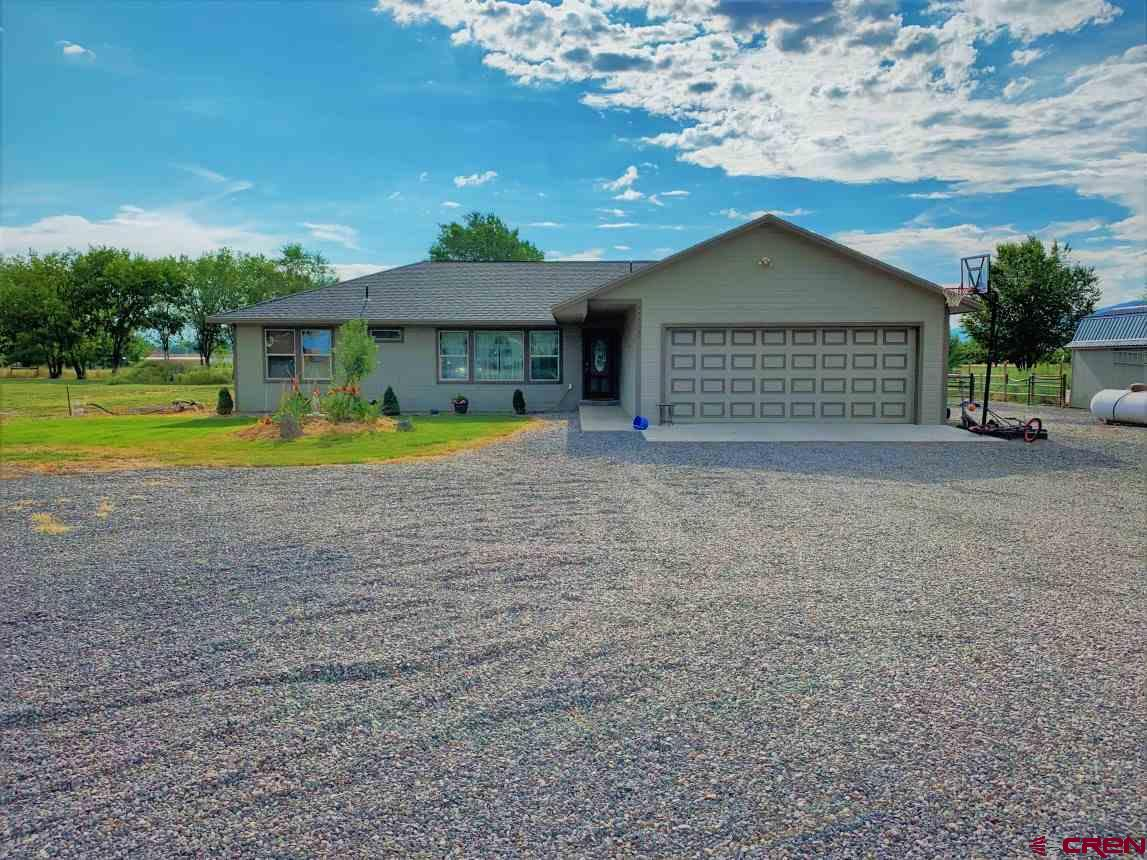 GEOTHERMAL 3 bedroom, 2 bath home on large corner lot on 2 acres.  Stainless steel appliances in the kitchen, beautiful laminate wood floors and spacious bedrooms, with an office/den option or a 4th bedroom. Covered deck in back to enjoy evening BBQ's and fenced backyard with fire pits. All of the homes in this small subdivision are on 2 acres, so plenty of elbow room and room for your horse or chickens as well. Irrigation water to house.