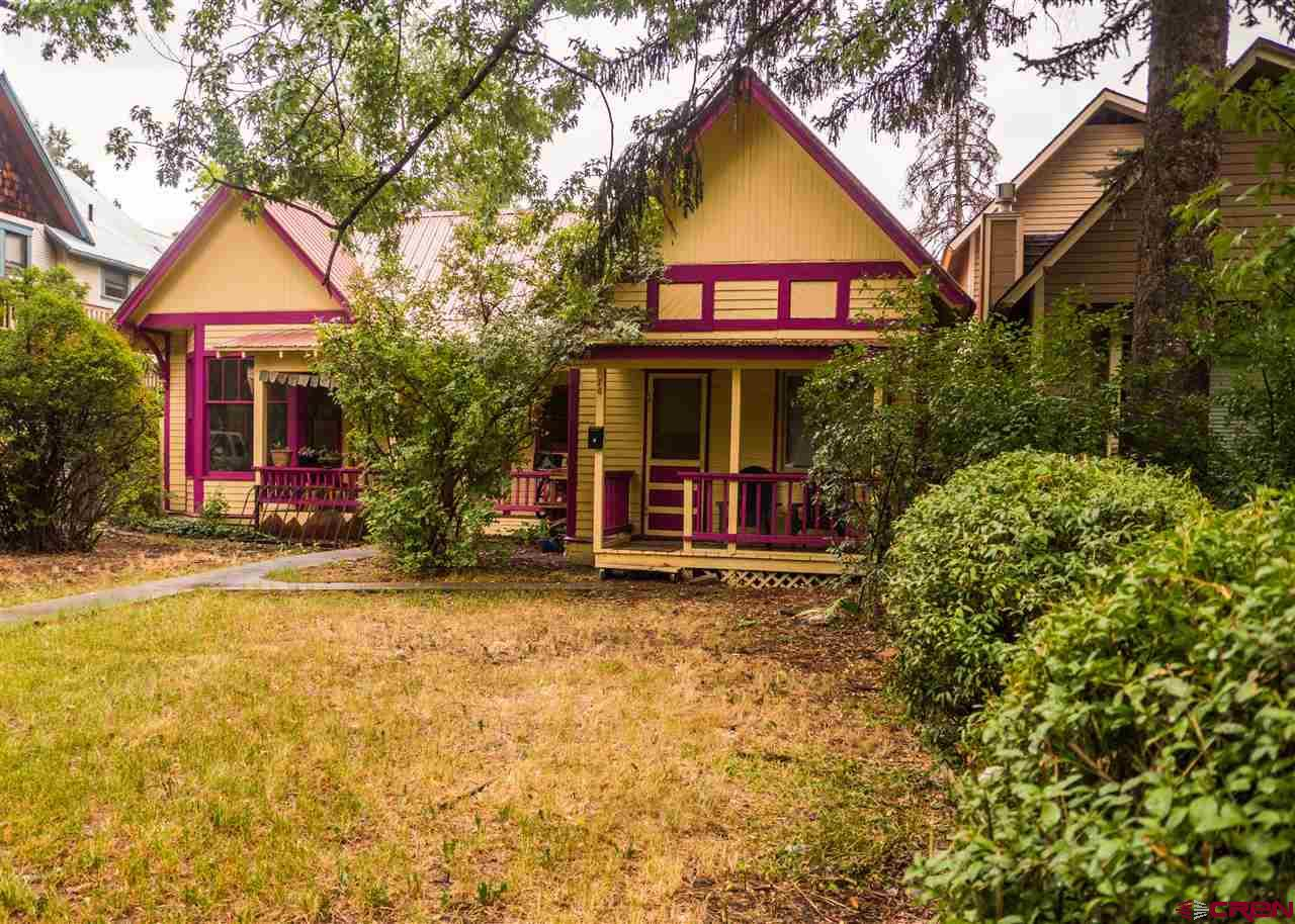 Legal duplex on .17 acre lot on E 3rd Ave in Durango. 2 bed, 1 bath with large living room and kitchen on one side, studio apt on other. Excellent location to central downtown Durango. Solid rental history. Detached Garage, storage shed, + 1 off alley parking spot. This home is due for some updating & renovation. Studio interior was renovated in 2007. Priced to 'fix and flip' or residence with built in income.