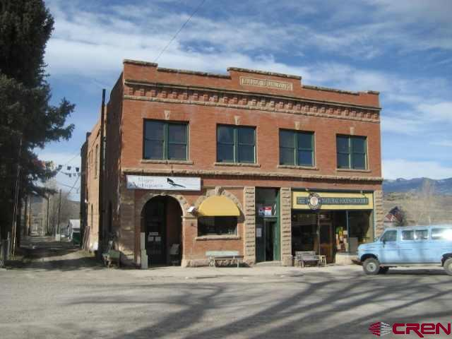 This classic 6000+ square foot  brick building is on the historical registry and has a prime location in the attractive, renovated heart of  Ridgway.  Ground level is two large retail spaces. Upstairs has 3 apartments,  2 offices and a lobby. All spaces are currently rented. There are many possibilities for this beautiful landmark.   Structural evaluation available.