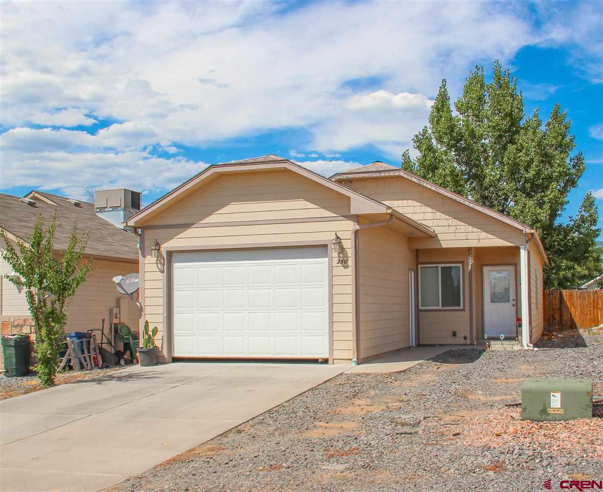 Affordable, one level, move-in ready Cedaredge home! Super convenient and low maintenance 3 bedroom/2 bathroom home with vaulted ceilings, granite throughout, SS appliances, 2 car attached garage, and on a very manageable small lot. Perfect if you're looking for minimal outdoor work, no stairs, and convenience to amenities!