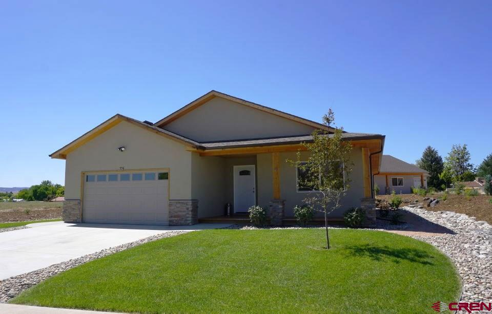 Nearly new home with construction completed December 2018. Mrs. Clean lives here: this home is immaculate! Open floor plan features vaulted ceiling and beautiful kitchen with hickory cabinets and granite countertop, upgraded range and refrigerator. Comfortable master bedroom and master bath with double vanity and roomy walk-in shower. The covered back deck opens off the dining room and the covered front porch looks out on Mt. Lamborn. The yard comes with an underground sprinkler system and has been extensively landscaped with trees, shrubs and sod. If you're looking for quality new construction and don't want to wait to have a home built, look no further!