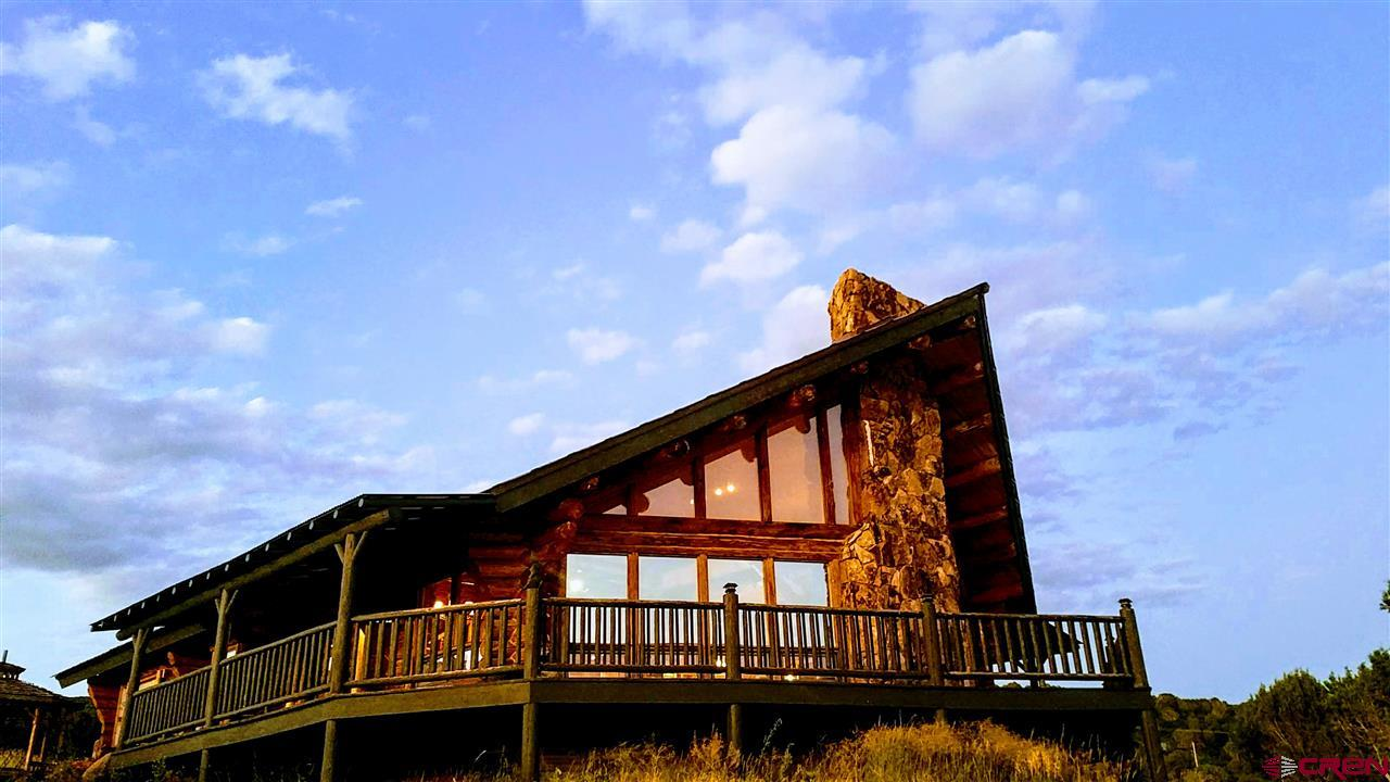 Here It Is! ~ The Perfect Colorado Mountain Log Home You've Been Looking For that's Modestly Price! Perched on 4 Acres on a Hill about 5-1/2 miles above the Charming Town of Cedaredge, this Gorgeous Custom Log Mountain Home offers Incredible Down Valley and Mountain Views of the West Elks, San Juans, Uncompahgre Plateau, and, of course, the Grand Mesa. Wonderful Upcountry Location, at the Base of the Grand Mesa, yet close to town (8 minutes to Cedaredge and 30 minutes to Delta), Plus, you are only about 20 minutes away from some of the Best Cross Country Skiing Areas in the World and 30 minutes away from Powderhorn Ski Resort! You are literally sitting right smack in the middle of a Vacation-Land Paradise, Colorado-Style, with access to World-Class Skiing, Fishing, Hunting, Hiking, Camping, Snowmobiling, Horseback Riding, Bicycling, River Rafting & Floating and More! It Simply doesnt get any Better than This! The Home Features a Large Open Great Room with a Lovely Kitchen, Dining Area with Extra Long Eating Bar that includes an Extra Cooktop, a Large Custom Rock Fireplace as a Focal Point of the Living Area, an Expansion of Massive Windows and a Huge Wrap-Around Deck to Enjoy those Magnificent Views! The Master Bedroom is on the Main Level and a 2nd Large Bedroom with its own Bath is on the Upper Level. The Current Family Room was once another Bedroom and could be turned back into one again. This is a True Log Home, Top Quality built by Frontier Log Homes. 2 Bonuses! - 1)There are 2 Engineered Septic Systems on this Property; 2) The Seller will Allow a $5,000 Credit toward Re-Finishing the Log Exterior!
