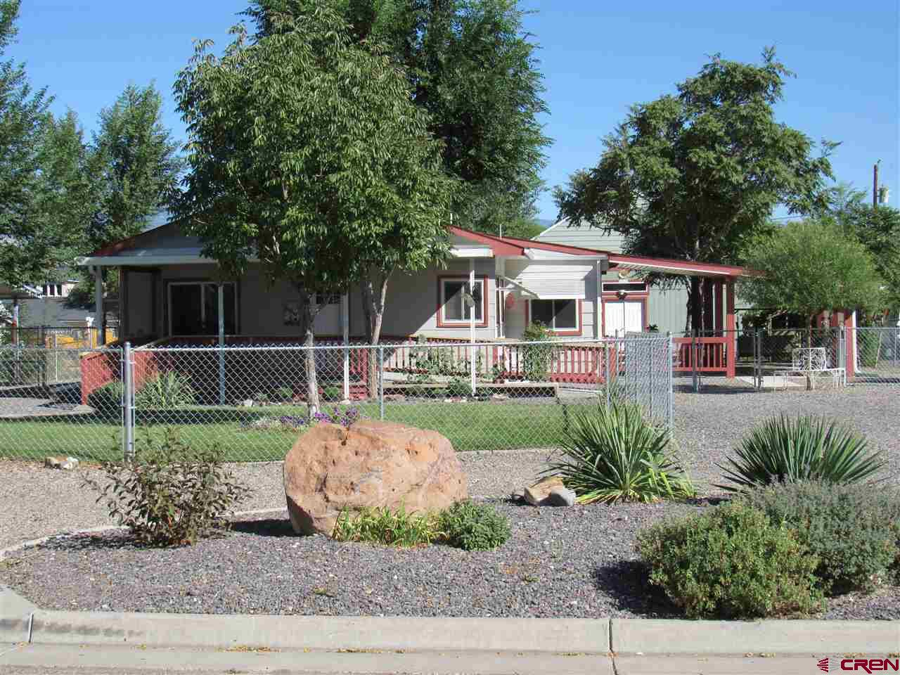 DON'T MISS OUT ON THIS BEAUTIFUL PROPERTY!!!  Located on Garnet Mesa, this property has an immaculately landscaped yard that is fully fenced with chain link.  HUGE over sized, detached two car garage with tons of storage and even a work area.   Lots of trees and bushes, mature grape vines and raspberries.   The home is currently a 2 bedroom, but could easily be converted back into a 3 bedroom.  Home was remodeled in 2015, with lots of upgrades including a new high efficiency furnace.  This home is handicap accessible.  This one is move in ready.....Don't wait to take a look, call today !