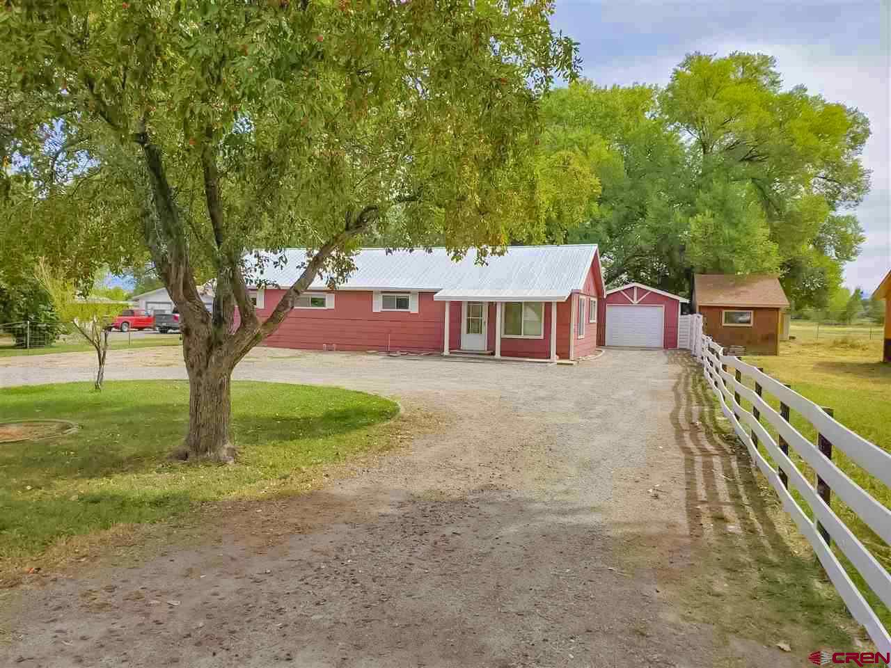 Freshly painted inside and out. New light fixtures, newer appliances (new or less than one year), 1 year old hot water heater and new carpet in bedrooms and family room. One car garage with attached workshop and shed in back yard. Great location!